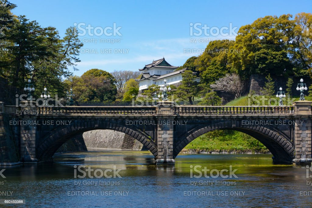Historic Seimon Ishibashi Bridge and guard tower turret at Tokyo Imperial Palace in Japan stock photo