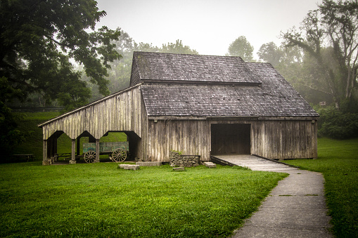 1800's style historic barn located and preserved in the Norris Dam State Park in the Appalachian Mountains of Tennessee.