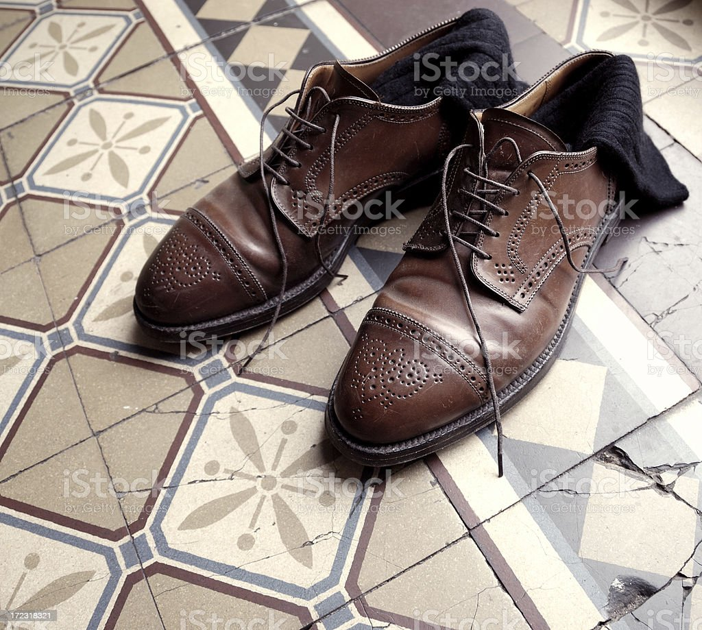 historic tiled floor and horse leather brogues stock photo