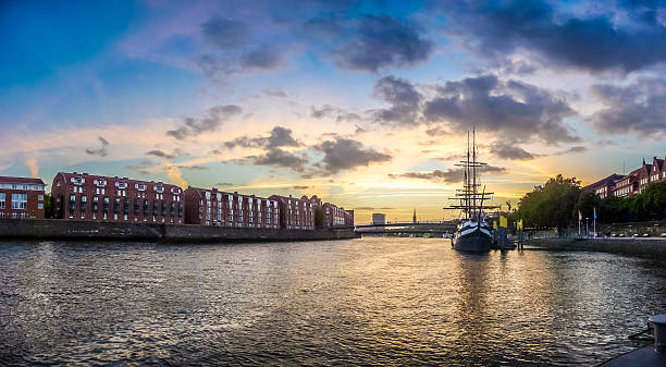 Historic town of Bremen with Weser river with dramatic clouds stock photo