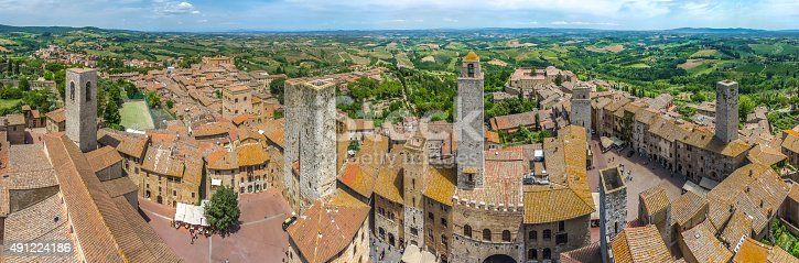 948424058istockphoto Historic town of San Gimignano with tuscan countryside, Tuscany, Italy 491224186