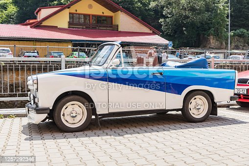 Hrensko, Czech Rep - July 19, 2020. Historic Trabant car modified as a cabriolet. White-blue trabant on a sunny day in Hrensko, Czech Republic.