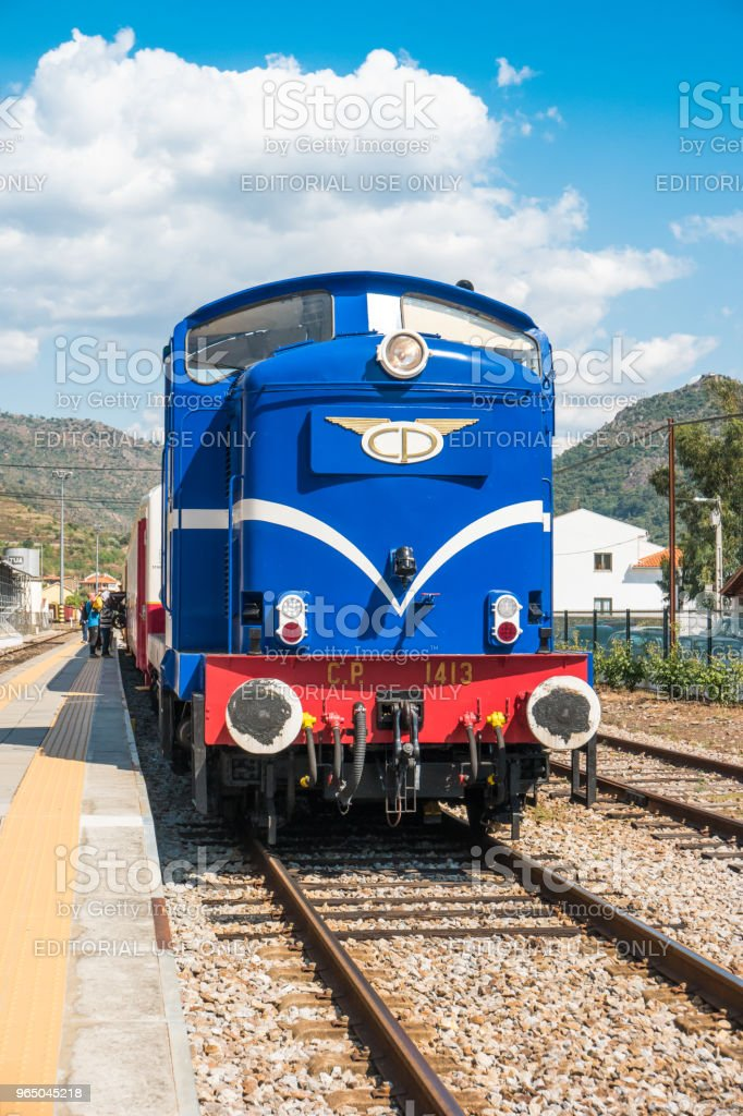 Historic train on Tua's Train Station. The train runs between June and October along the bank of the river Douro. zbiór zdjęć royalty-free