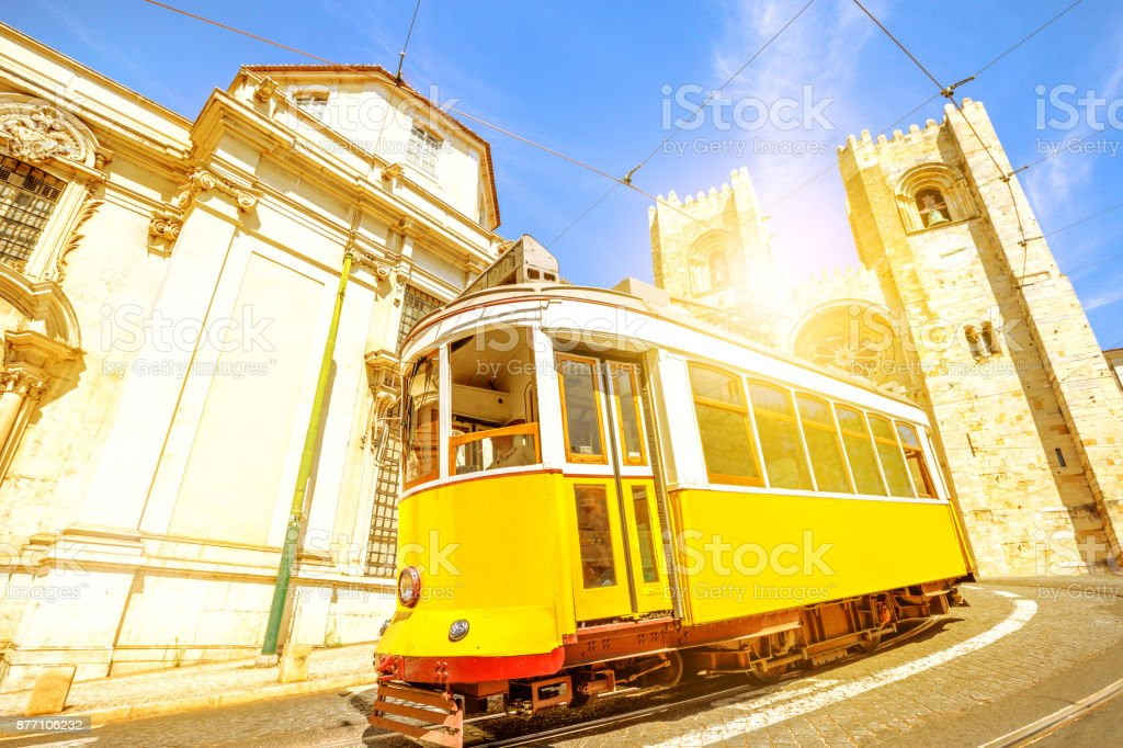 Historic tram and Lisbon Cathedral stock photo