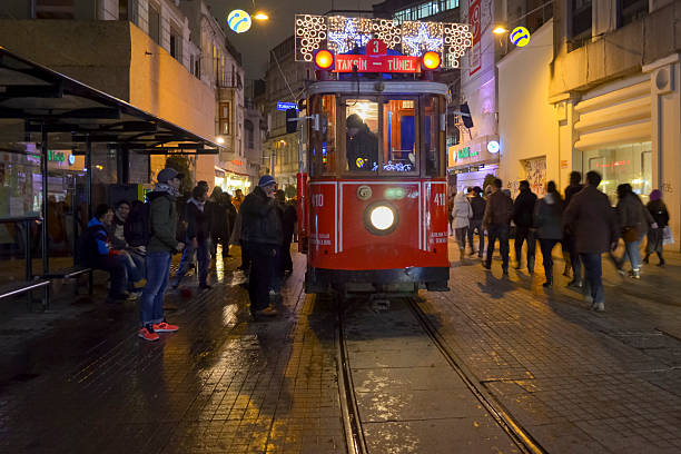 Historic tram on Istiklal Avenue. Istiklal Avenue Christmas season Istanbul, Turkey - September 21, 2012: the former tram on Istiklal Street in Istanbul, Taksim-Tunel carry passengers. A cold winter day. time magazine stock pictures, royalty-free photos & images