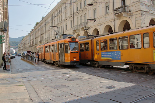 historic trams of Turin pass along the central Via Po, Italy