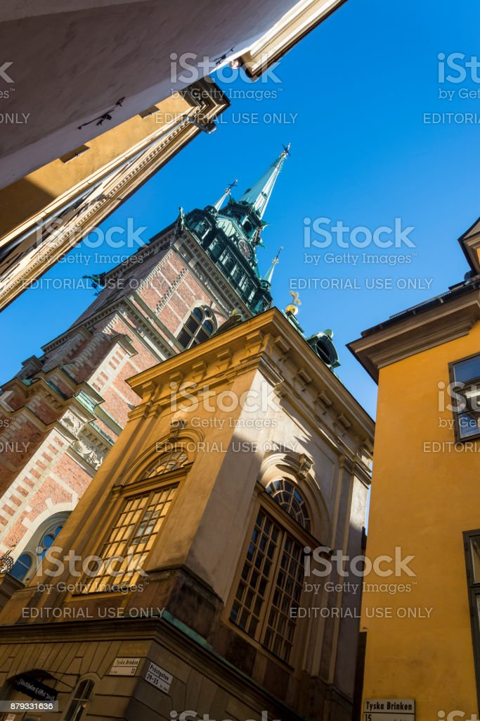 Historic Tyska Kyrkan or German Church with it's iconic spire located in Gamla Stan (Old Town), Stockholm, Sweden stock photo