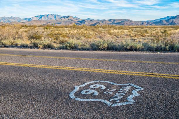 Historic US Route 66 highway sign on asphalt