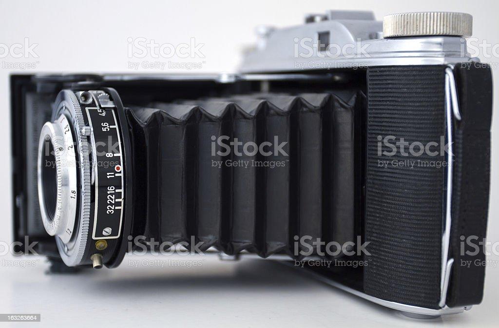 Historic used photo camera edgewise stock photo