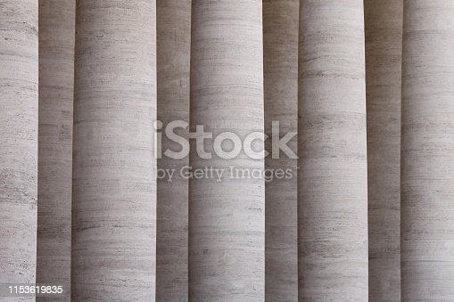 istock Historic vertical marble columns as stone background 1153619835