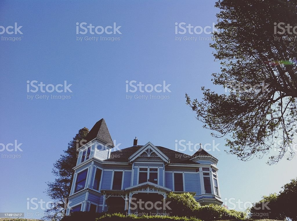Historic Victorian Blue House on a Hilltop stock photo