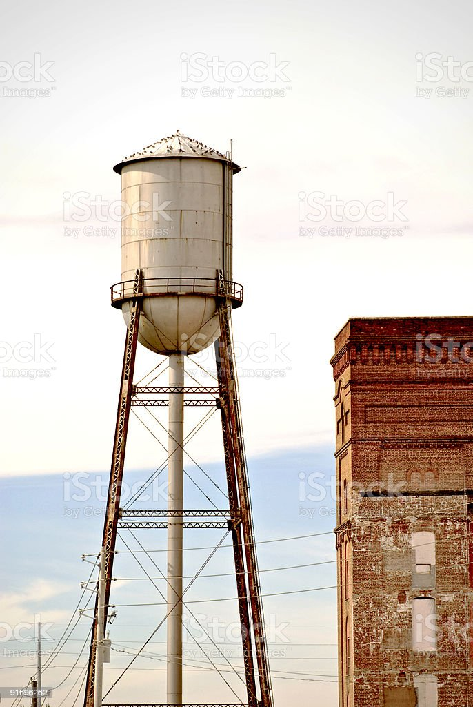 Historic water tower and an old building in Columbus Georgia stock photo