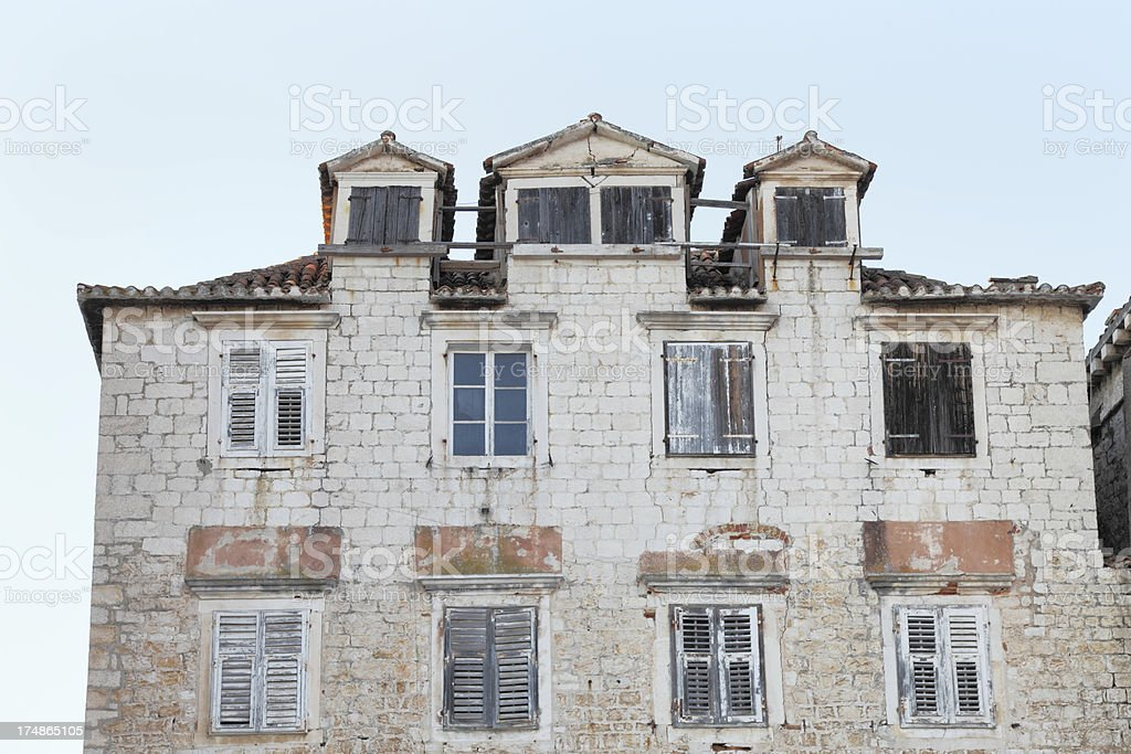 historic weathered house facade with windows   Croatia royalty-free stock photo