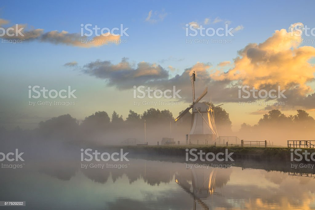 Historic White wooden under colorful sunrise stock photo