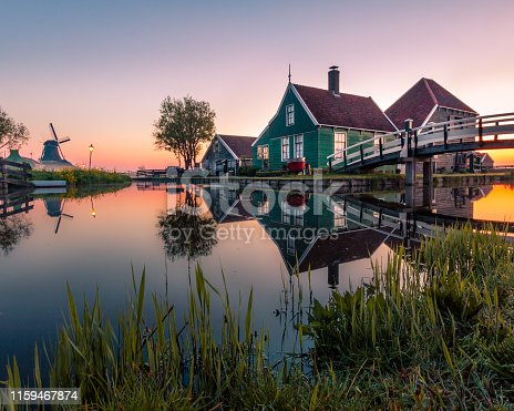 Historic wooden house in the Netherlands at sunrise.