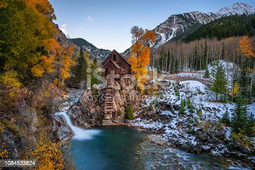 Historic wooden powerhouse called the Crystal Mill in Colorado with colorful autumn colors. It is located on an outcrop above the Crystal River in Crystal ghost town and was built in 1892.