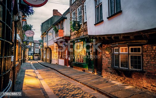The Shambles, a medieval street preserved in the heart of the English city of York, still busy with boutique shops and cafes.