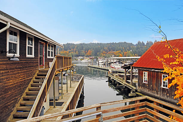 HIstorica old House in Gig Harbor. Pacific Northwest. Old wooden houses with water front view. View of private boats gig harbor stock pictures, royalty-free photos & images