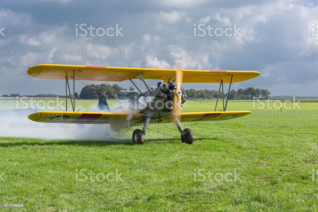 Historical airplane with pilot is ready to take off stock photo
