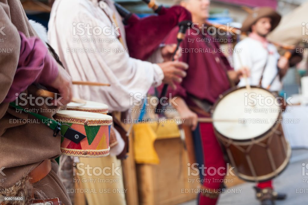 Historical bagpiper and drummer dressed in ancient clothes stock photo