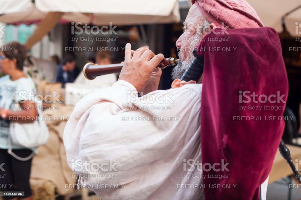 Historical bagpiper dressed in ancient clothes stock photo