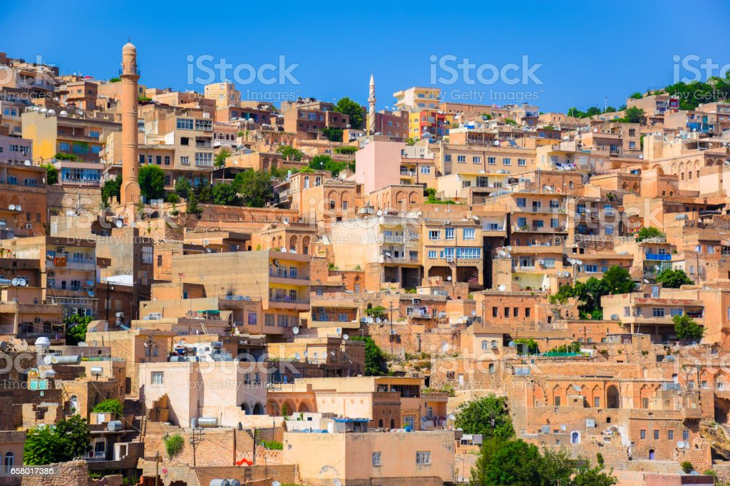 Historical beige colored limestone rock buildings with many satellite dishes on tops stock photo