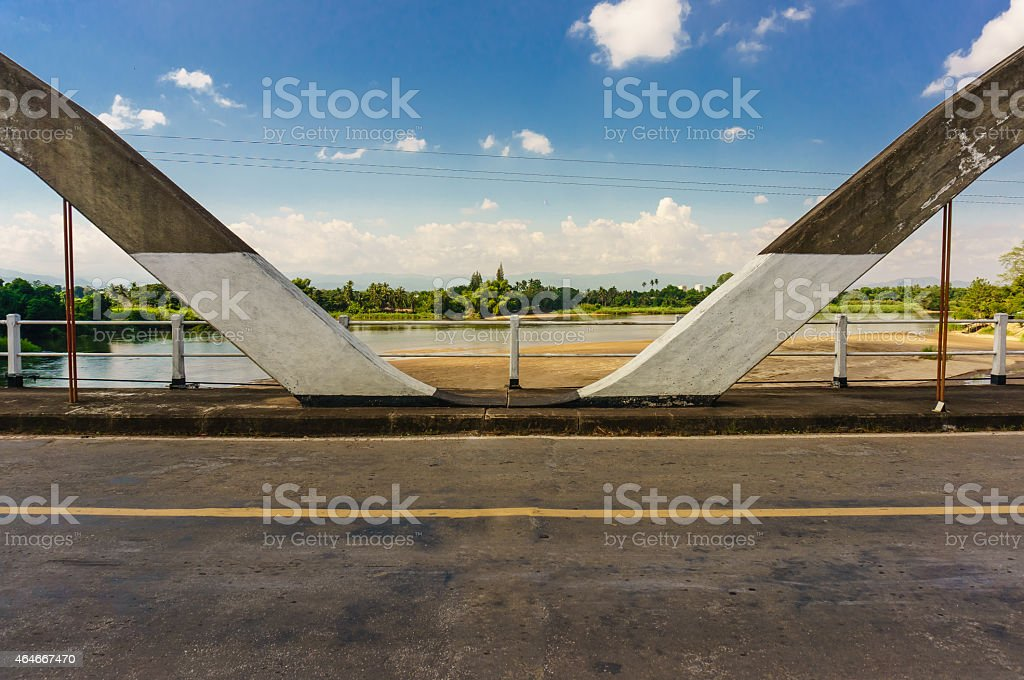 Historical bridge over the river with shade stock photo