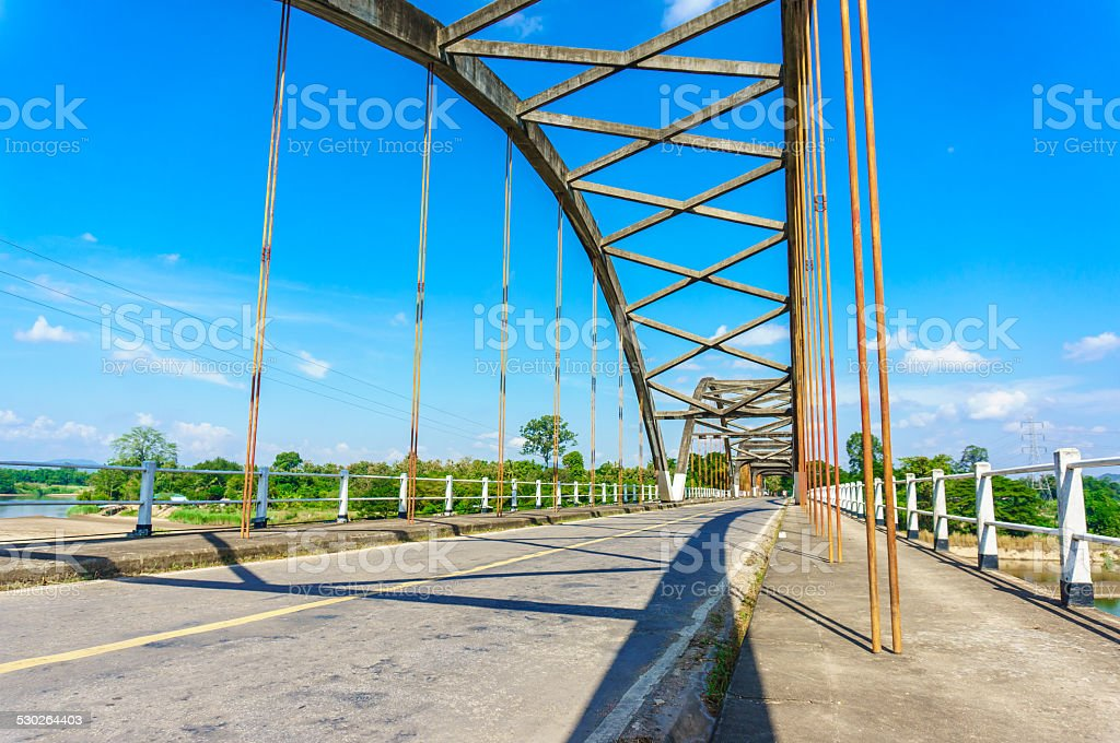 Historical bridge over the river with shadow stock photo
