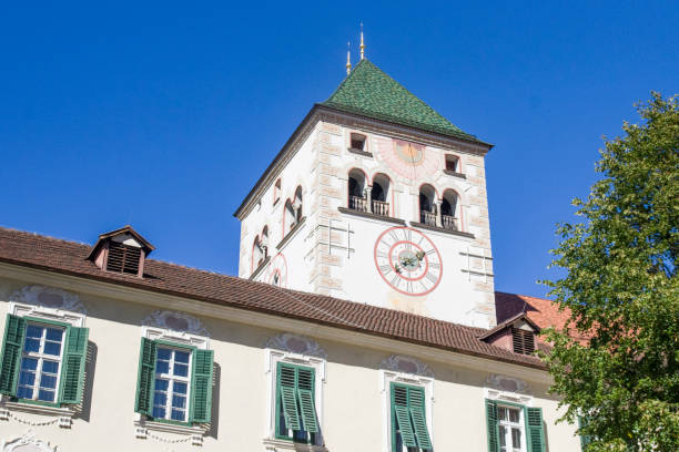 historical building of the abbey of novacella, ancient alpine monastery, wine producer stock photo