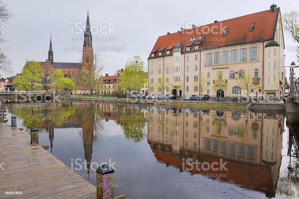 Historical buildings reflecting in the water in Uppsala, Sweden. stock photo