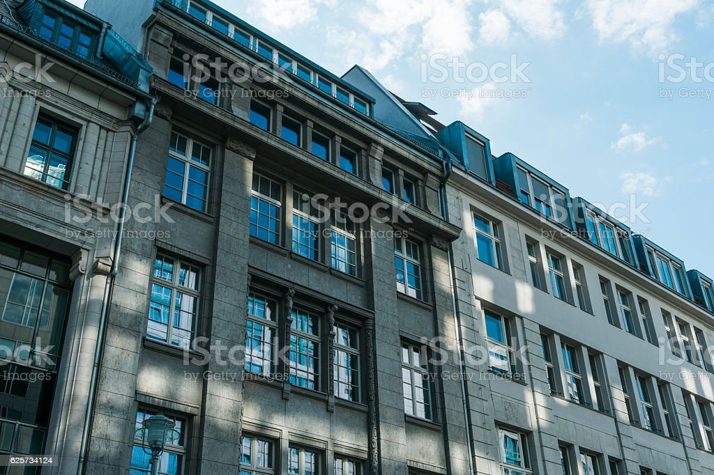 historical buildings with light reflections on the facade stock photo