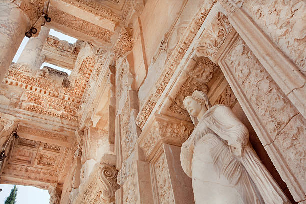 Historical Celsus Library of Ephesus city, 10th century BC Ceiling of historical Celsus Library of Ephesus city with antique sculpture at entrance, Turkey. Greek city Ephesus founded on 10th century BC. ephesus stock pictures, royalty-free photos & images