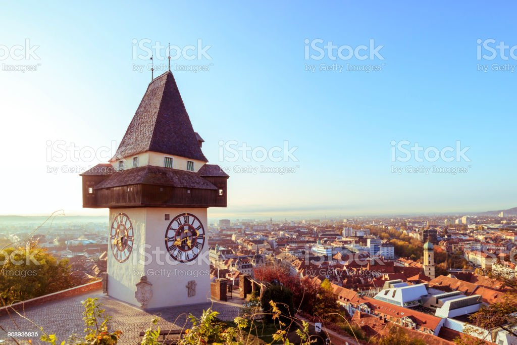 Historical Clock tower Uhrturm and old town in Graz, Austria stock photo