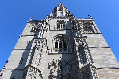 Historical Constance Cathedral (Konstanzer Muenster) isolated on blue sky in the city of Constance (Konstanz) in Baden-Wuerttemberg, Germany.