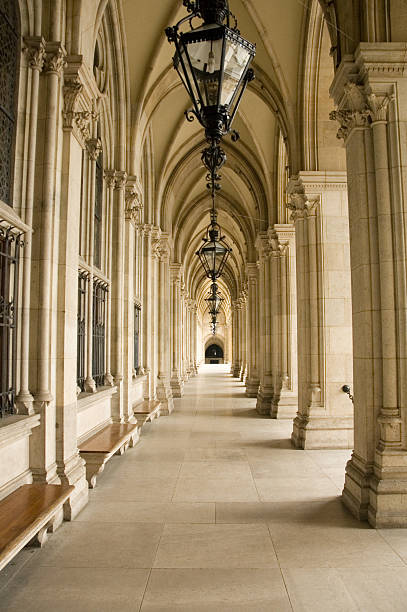 Historical corridor with columns Historical corridor with columns and seats in Vienna town hall. mahroch stock pictures, royalty-free photos & images