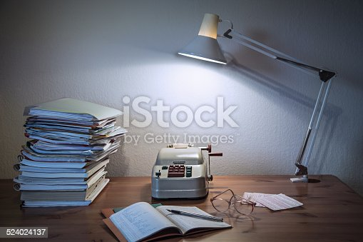 istock Historical Desk with old calculating machine 524024137