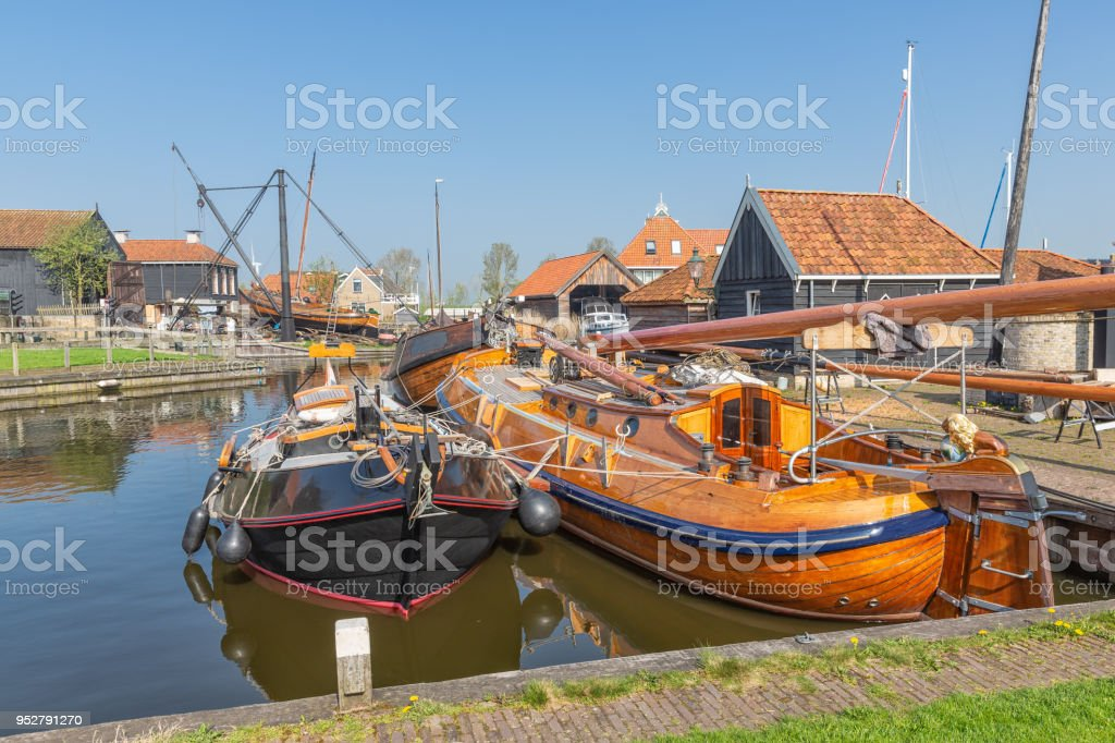 Historical fishing vessels anchored in harbor Dutch fishing village Workum stock photo