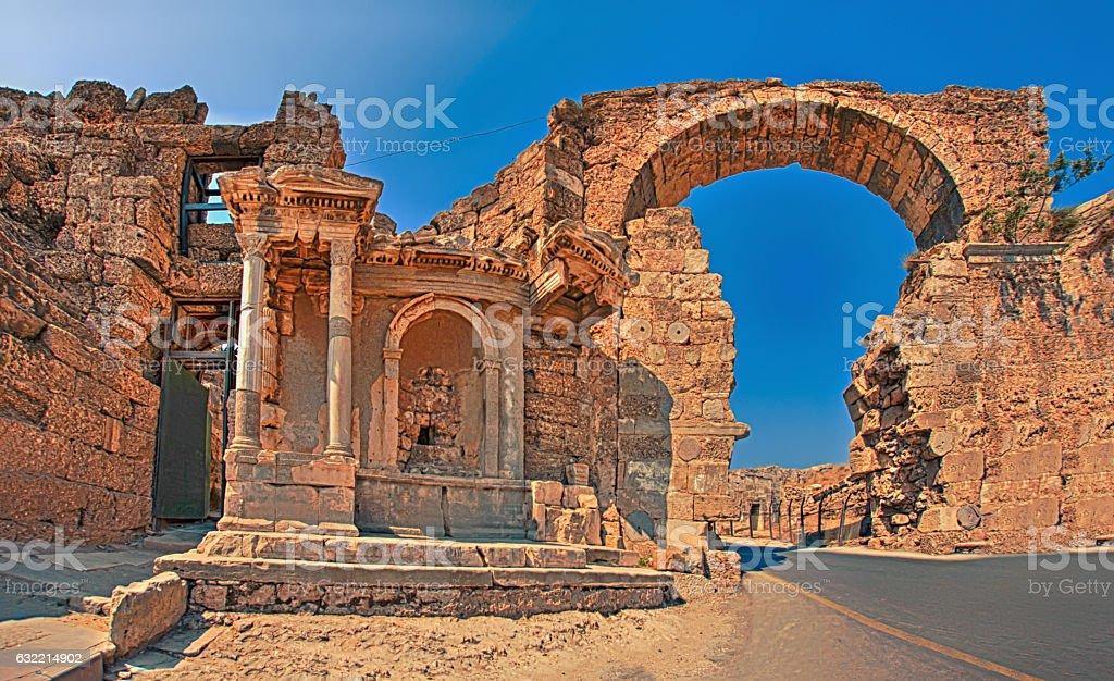 Historical fountain and vespasian door in Side Antalya Turkey stok fotoğrafı