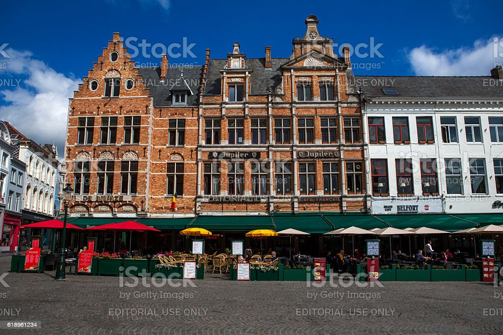 historical gothic buildings at market place in brugge belgium stock photo
