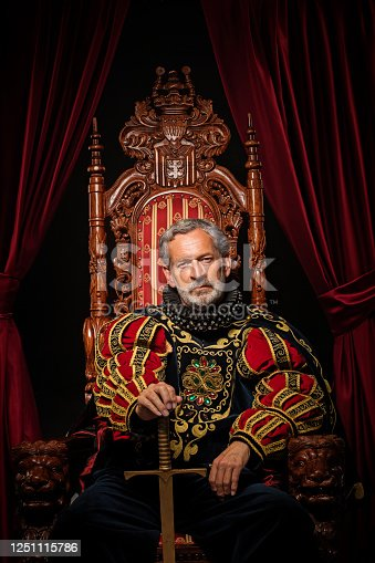 Historical King on the throne in studio shoot