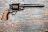 A historical pistol on vintage wooden table