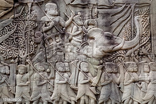 1147569123 istock photo Historical relief with Khmer soldiers and elephants on the 12th century wall of Bayon temple, Cambodia. 1218035220