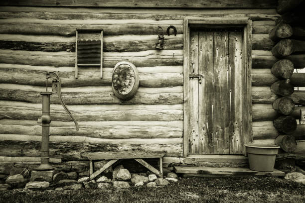 Historical Retro Style Pioneer Log Cabin stock photo