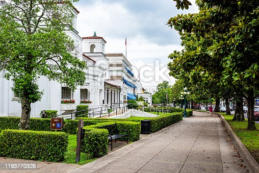 Hot Springs, USA - June 4, 2019: Historical Spa bath house street row architecture building in historic city with trees