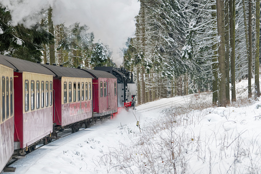 Historical steam train in Harz area on the way to Brocken mountain