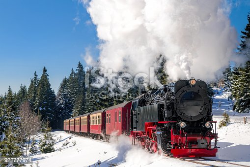 istock Historical steam train running full speed to Brocken Mountain in Harz region 922777974