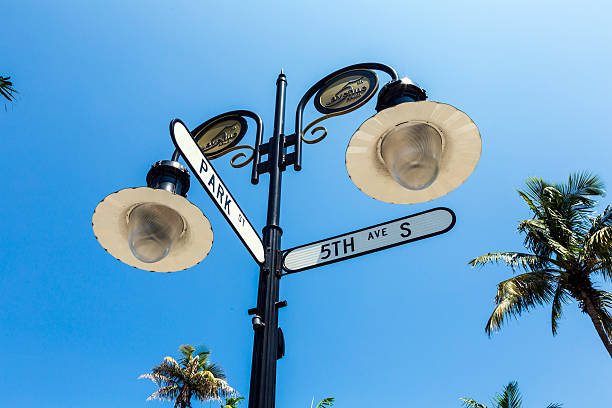 historical street sign in Naples, Florida historical street sign in Naples, Florida under blue sky naples florida stock pictures, royalty-free photos & images
