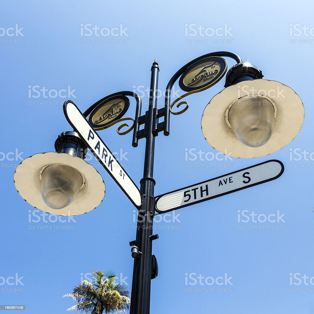 historical street sign in Naples, Florida under blue sky royalty-free stock photo