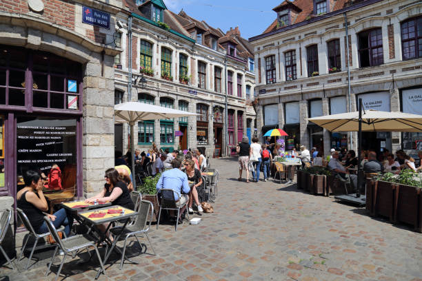 Historical street with tourists in Lille, France stock photo
