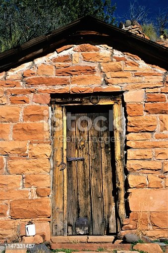 Historical Taylor Cabins front door Sedona Arizona USA.  Red Rock country.  Red sandstone probably hand hewn.